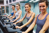 Happy women on exercise bikes