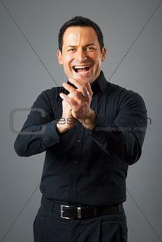 man claps his hands