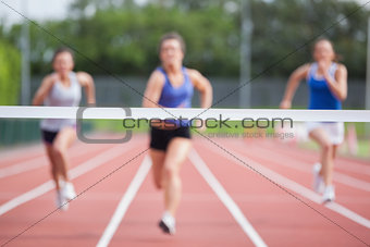 Athletes racing towards finish line