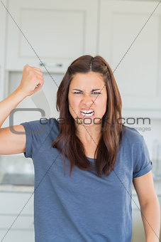 Angry woman holding knife