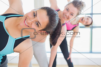 Women smiling while stretching
