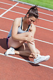 Female runner with ankle injury
