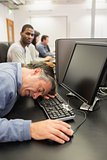 Man taking nap at computer class