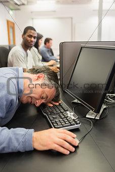 Man taking nap at computer class