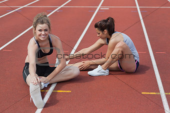 Women stretching on the track