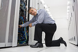 Man fixing server wires