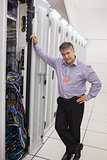 Man standing next to a server tower