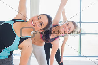 Happy women stretching