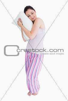 Standing woman sleeping on a pillow