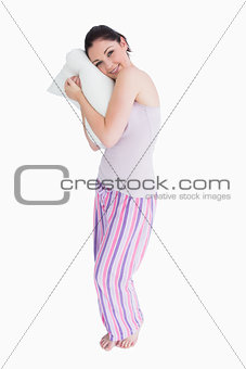 Standing woman relaxing on her comfortable pillow