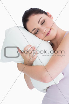 Smiling woman sleeping on pillow