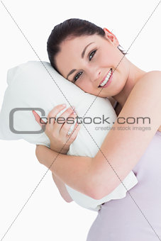 Smiling woman waking up on her pillow
