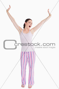 Standing woman stretching and yawning