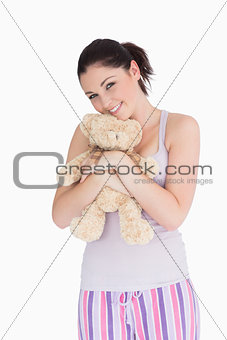 Smiling woman holding a teddy bear