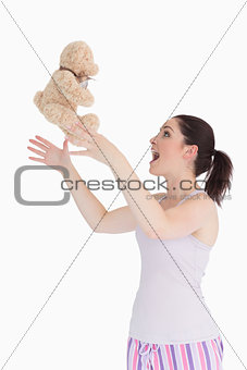 Woman throwing her teddy bear