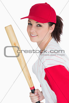 Smiling woman with baseball bat and hat