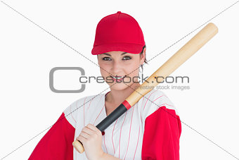 Woman holding a bat on her shoulder