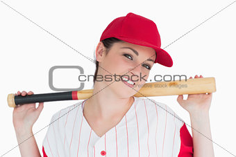 Woman holding a bat on her shoulders