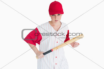 Woman holding a bat seriously