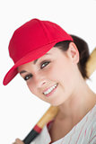 Happy woman with baseball bat and hat