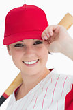 Woman holding a bat and her cap