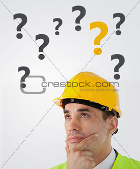 Man in hard hat thinking