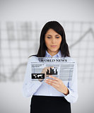Businesswoman reading a virtual newspaper