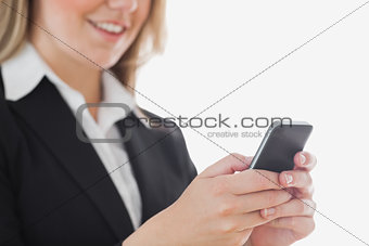 Closeup of business woman using cell phone