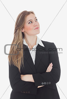 Thoughtful businesswoman looking up
