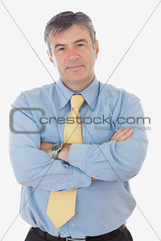 Portrait of mature businessman with arms crossed