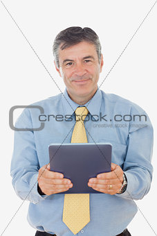 Portrait of businessman holding digital tablet