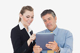 Business people using tablet together
