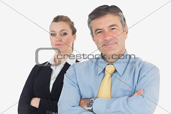 Confident business people with arms crossed