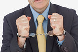 Closeup of businessman with handcuffed hands