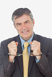 Businessman with handcuffed hands