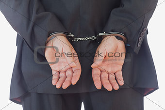 Closeup of handcuffed businessman