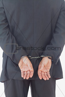 Rear view of businessman with handcuffs