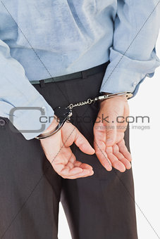 Rear view of businessman in handcuffs