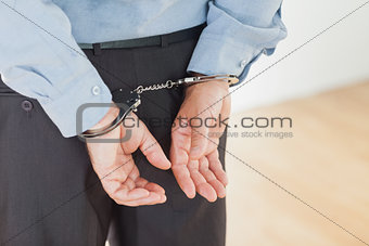 Hands of businessman with handcuffs