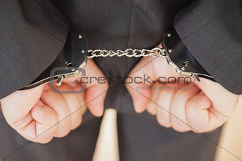 Attrested businessman clenching fists