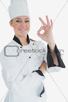 Happy female chef gesturing ok sign
