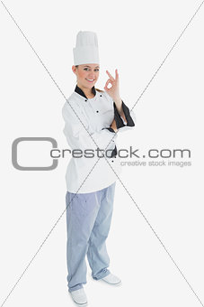 Portrait of female chef gesturing ok sign