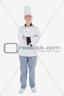 Happy chef standing with arms crossed