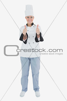 Female chef gesturing thumbs up sign