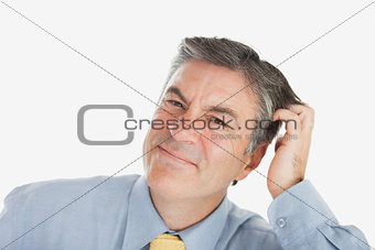 Portrait of businessman scratching head