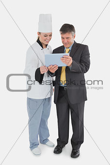 Businessman and chef using digital tablet