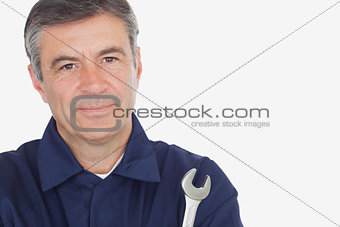 Portrait of mature machanic with wrench