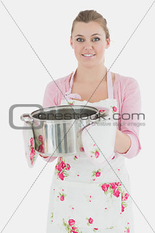 Portrait of young maid with cooking utensil