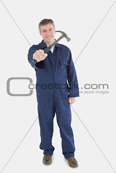 Portrait of technician holding hammer