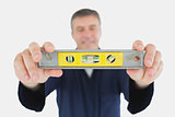 Technician holding spirit level